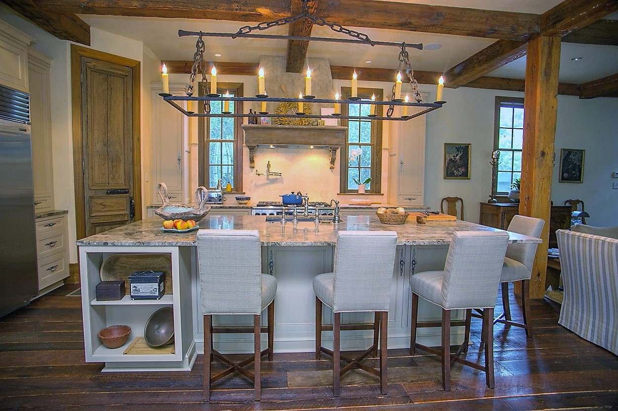 Kitchen photo showing rustic lighting and seating