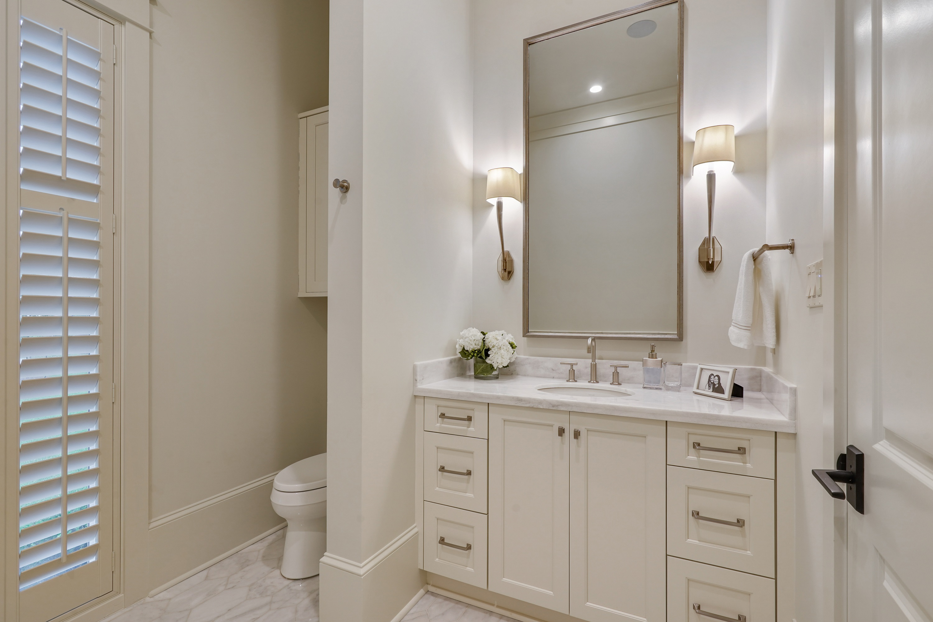 White vanity cabinetry in Covington Traditional-style bathroom